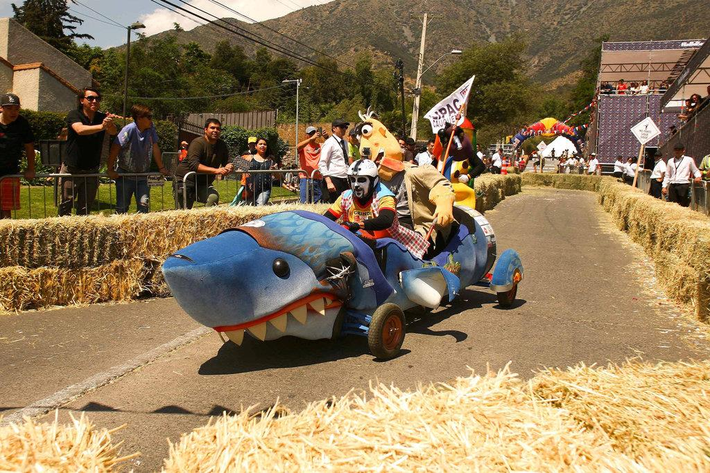 Competitors ride a home-made vehicle without an engine on a downhill track in the Red Bull Soapbox Race in Santiago, Chile, November 27, 2016. REUTERS/Jonathan Faus