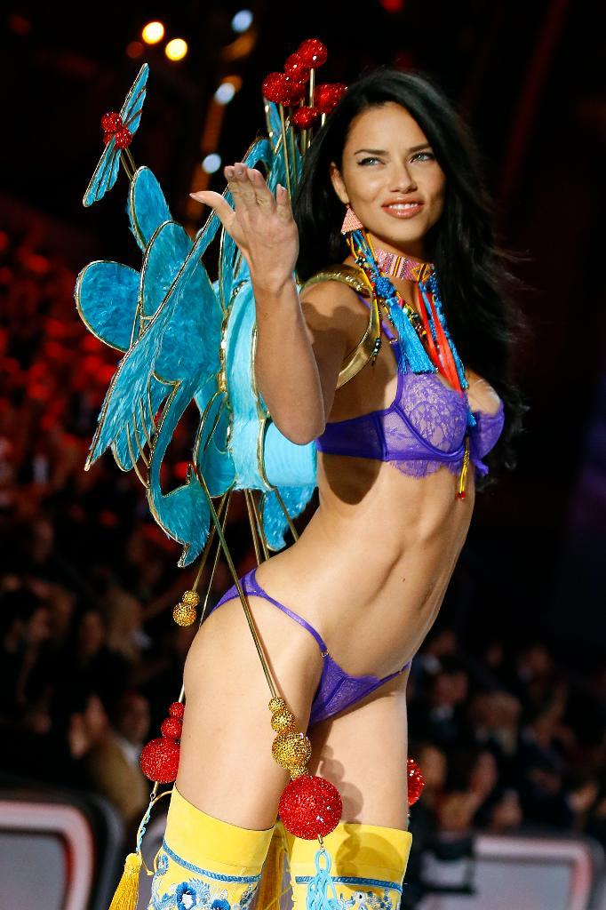 Model Adriana Lima displays a creation during the Victoria's Secret Fashion Show inside the Grand Palais, in Paris, Wednesday, Nov. 30, 2016. The pulse-quickening, celebrity-filled catwalk event of the year : the Victoria's Secret fashion show takes place in Paris with performances from Lady Gaga and Bruno Mars. (AP Photo)