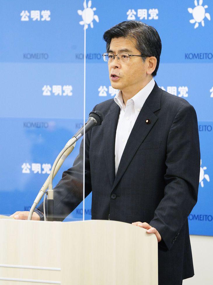 記者会見する公明党の石井啓一幹事長=24日午前、国会