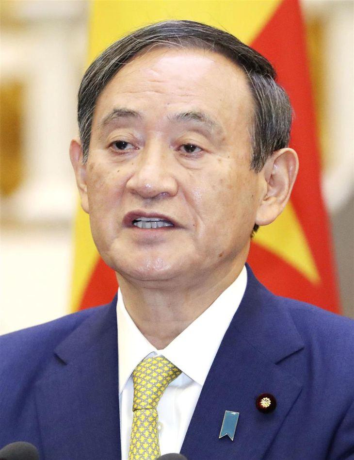共同記者発表に臨む菅首相=19日、ハノイ(代表撮影・共同)